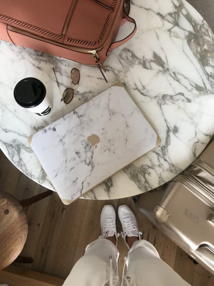 Travel Essentials marble macbook cover