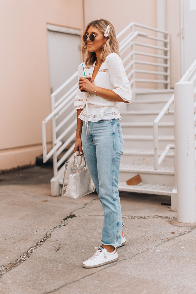 fashion blogger wearing golden goose superstar sneaker styled with high waisted jeans
