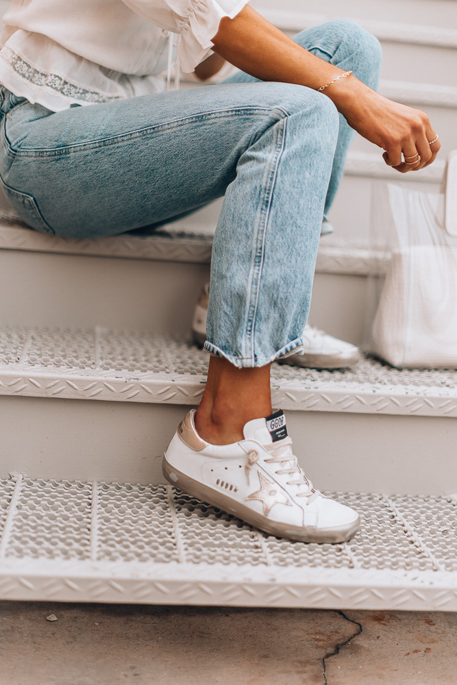 white and gold distressed golden goose delux brand superstar sneakers