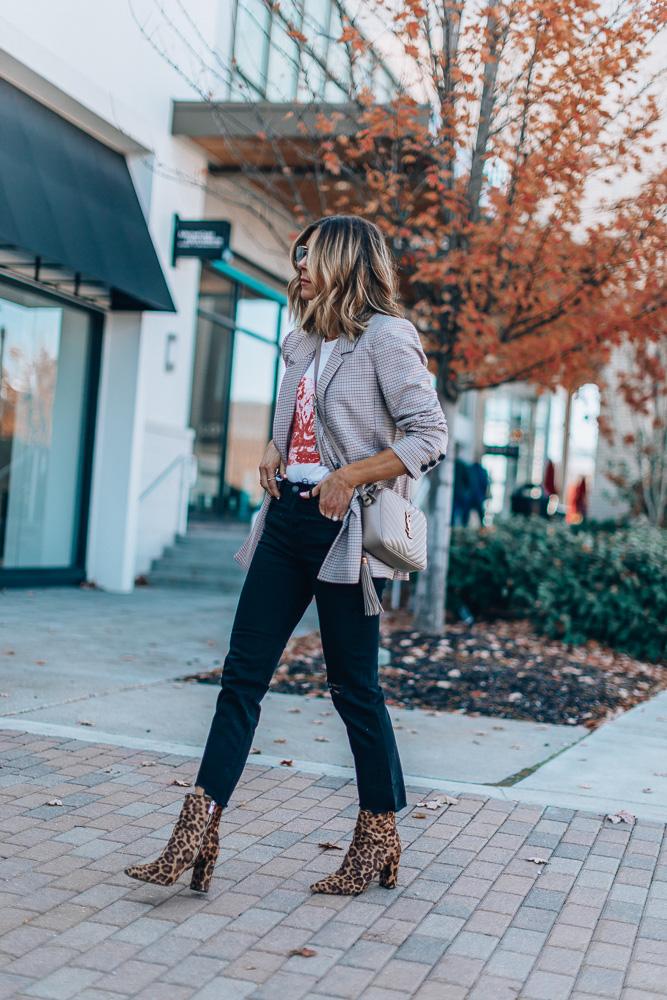 fashion blogger cella jane wearing annie bing plaid blazer with graphic tee dark skinny jeans leopard print booties